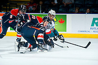 KELOWNA, CANADA - FEBRUARY 6: Brady Gaudet #23 of Kamloops Blazers checks Tyrell Goulbourne #12 of Kelowna Rockets to the ice during first period on February 6, 2015 at Prospera Place in Kelowna, British Columbia, Canada.  (Photo by Marissa Baecker/Shoot the Breeze)  *** Local Caption *** Brady Gaudet; Tyrell Goulbourne;
