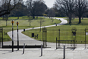As the second week of the UK government's Coronavirus lockdown ends on a fine Spring weekend, and 24hrs after it was reported that 3,000 Londoners had been counted in Brockwell Park, Herne Hill, resulting in the closure of this significant public green space by Lambeth council, an empty path and grass in the park (See a similar view with many people 2 days before in Getty image #1209106121), on 5th April 2020, in London, England.