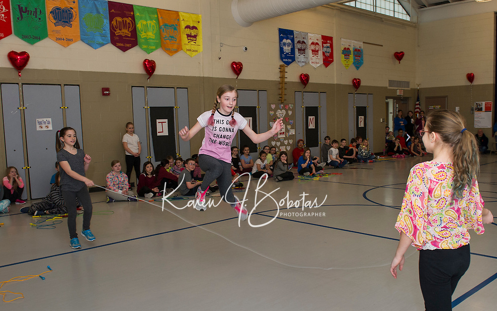 McKenzie Laflamme, Haley Greenwood and Lacy Linkkila perform their skip rope routine at Elm Street School's Jump Rope for Heart event on Friday morning.  (Karen Bobotas/for the Laconia Daily Sun)