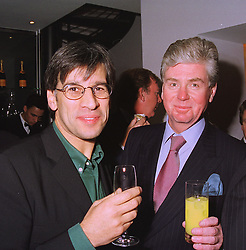 Left to right, TV Baptist Minister REV.STEVE CHALKE and MR MICHAEL COLE former spokeman for Harrods owner Mohamed Al Fayed, at a party in London on 21st December 1998.MNB 19