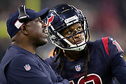 Houston Texans wide receiver DeAndre Hopkins (10) looks at the scoreboard with a Texans coach on the sideline during the NFL week 8 regular season football game against the Miami Dolphins on Thursday, Oct. 25, 2018 in Houston. The Texans won the game 42-23. (©Paul Anthony Spinelli)