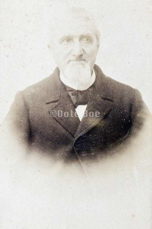 fading 1900s portrait of adult man