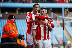 Stewards usher away Stoke Forward Marko Arnautovic (AUT) who is hugged by goalscorer Geoff Cameron (USA) and Forward Peter Crouch (ENG) after going over to the Aston Villa fans - Photo mandatory by-line: Rogan Thomson/JMP - 07966 386802 - 23/03/2014 - SPORT - FOOTBALL - Villa Park, Birmingham - Aston Villa v Stoke City - Barclays Premier League.