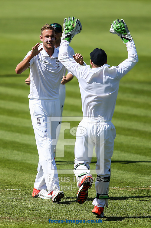 Stuart Broad of England (left) celebrates taking the wicket of Shane Watson of Australia (not shown) with Jos Buttler of England (right) during the Investec Ashes Series Test Match at Sophia Gardens, Cardiff<br /> Picture by Andy Kearns/Focus Images Ltd 0781 864 4264<br /> 10/07/2015