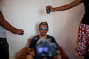 MC Marek also called the Black Devil - 21 years old Roma rapper - during a shoot for a music video by the group Roma Film Makers (RFM) in a improvised garage in Moldava nad Bodvou. The city has roughly 11200 inhabitants, about 1980 (18%) of them have Roma ethnicity and around 800 are living at the segregated settlement 'Budulovska Street' (2014).