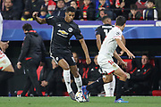 Manchester United Forward Marcus Rashford battles with Sevilla midfielder Ever Banega (10) during the Champions League match between Sevilla and Manchester United at the Ramon Sanchez Pizjuan Stadium, Seville, Spain on 21 February 2018. Picture by Phil Duncan.