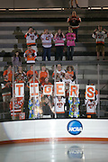 RIT fans cheer during introductions for an exhibition game between RIT's Women's Hockey team and Pursuit of Excellence, a junior team from British Columbia, at RIT's Gene Polisseni Center on Monday, September 29, 2014.