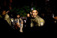 Sharia Police, or the morality police, line up for night patrol duty in Banda Aceh, Indonesia, on Saturday, Nov. 21, 2009. Banda Aceh enforces a moderate form of Islamic Law.