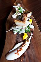 Seared Spanish mackerel, orange peel puree, fresh white cheese, and a fennel and pine nut salad. © Allen McEachern.