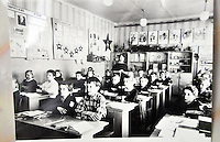 A vintage photograph, displayed in a room with other memorabilia from the Soviet era, from the only school in Kirillov, a small town of about 8,000 on the shores of Lakes Siverskoye and Dolgoye near Vologda, the district center. Students have the full three months of summer off, a must in an area that is locked in by snow and ice much of the winter. Freshly painted classrooms and new double-pane storm windows awaited their return.