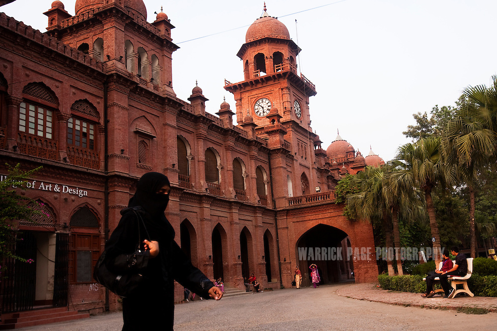LAHORE, PAKISTAN - JULY 6: A woman wearing a niqab walks through Punjab University's old campus on July 6, 2011, in Lahore, Pakistan. Islamic groups are using increasing intimidation tactics in universities against progressive liberal youth throughout universities in Pakistan.  (Photo by Warrick Page)