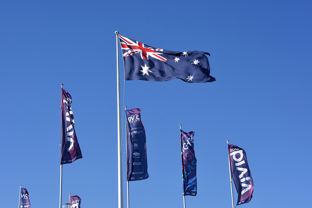 Austrlian Flag and Vivid Sydney 2017 flags against a blue sky