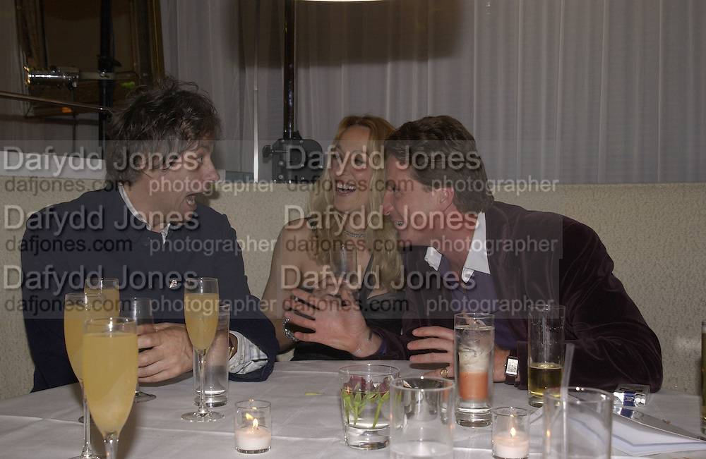Sir Bob Geldof, Jerry Hall and Tim Attias,  An evening at Sanderson in aid of Sargent Cancer Care for children. Sanderson Hotel. 28 May 2002. © Copyright Photograph by Dafydd Jones 66 Stockwell Park Rd. London SW9 0DA Tel 020 7733 0108 www.dafjones.com