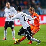 NLD/Amsterdam/20121114 - Vriendschappelijk duel Nederland - Duitsland, Ilkay Gundogan in duel met Dirk Kuyt