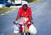 Out of focus picture woman cycling Cayman Brac, Cayman Islands, West Indies c 1990
