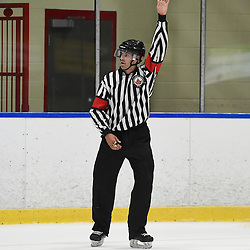 WHITBY, ON - SEP 22,  2016: Ontario Junior Hockey League game between Georgetown and Whitby, OHA Referee Ben Smith makes a call during the first period.  <br /> (Photo by Andy Cornea / OJHL Images)