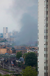 Anna Branthwaite, Camden, London<br /> 19/05/2014<br /> View of massive fire in Camden Town with a train arriving at Euston train station, running close by.<br /> Photo: Anna Branthwaite/LNP
