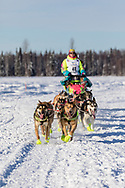 Musher Monica Zappa after the restart in Willow of the 46th Iditarod Trail Sled Dog Race in Southcentral Alaska.  Afternoon. Winter.
