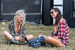 © Licensed to London News Pictures. 22/08/2014. Reading, UK.   Festival goers at Reading Festival 2014 on Friday morning, the opening day.  Here they wait for the gates to the main festival arena open.   The weather is sunny with light cloud.   Today is expected to remain dry with a 25% risk of showers.  Photo credit : Richard Isaac/LNP