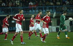 Denmark national team and Valter Birsa of Slovenia (right) after the first goal (penalty shot) of Denmark during the UEFA Friendly match between national teams of Slovenia and Denmark at the Stadium on February 6, 2008 in Nova Gorica, Slovenia. Slovenia lost 2:1. (Photo by Vid Ponikvar / Sportal Images).