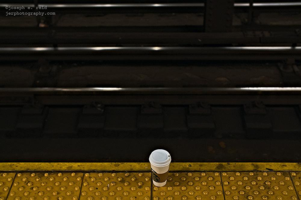 Cup of tea left on edge of subway platform