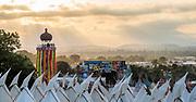 Waitng for teh sun to set on the hill above the festival - The 2019 Glastonbury Festival, Worthy Farm. Glastonbury, 26 June 2019