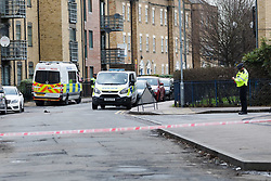 © Licensed to London News Pictures. 04/02/2018. London, UK. Police at the crime scene in Abbey Road, Barking. A 19 year old man suffering stab wounds was attended to by emergency services last night and was prouncounced dead at the scene at 22:55. Photo credit: Vickie Flores/LNP