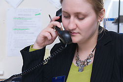 Polish office worker using the telephone at work,
