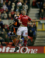 Photo: Richard Lane/Richard Lane Photography. Nottingham Forest v Blackpool. Coca Cola Championship. 13/12/2008. Chris Cohen (R) and Joe Martin (L) in the air