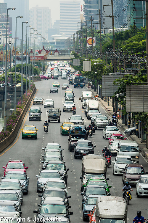 06 JUNE 2013 - BANGKOK, THAILAND:  Traffic on Sathorn Road in Bangkok. Sathorn Road is one of Bangkok's main thoroughfares. There are several high rise hotels and many corporate offices on the road, which runs from the Chao Phraya River to Lumpini Park.       PHOTO BY JACK KURTZ