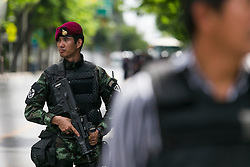 © Licensed to London News Pictures. 23/05/2014. A Royal Thai Army officer on guard outside the Army auditorium where prominent figures including Yingluck reported to the kingdom's military junta in Bangkok. Thailand's army said on May 23 that 155 prominent figures, including Yingluck and ousted government leaders, were banned from leaving the country without permission following a military coup.  Photo credit : Asanka Brendon Ratnayake/LNP
