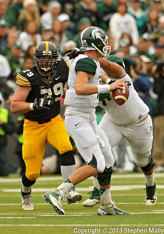 October 6 2013: Iowa Hawkeyes defensive lineman Dominic Alvis (79) eyes Michigan State Spartans quarterback Connor Cook (18) during the first quarter of the NCAA football game between the Michigan State Spartans and the Iowa Hawkeyes at Kinnick Stadium in Iowa City, Iowa on October 6, 2013. Michigan State defeated Iowa 26-14.