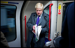 The London Mayor Boris Johnson on the tube to Liverpool Street Station to catch a train to Stamford Hill, London, Thursday April 5, 2012. Photo By Andrew Parsons/ i-Images...