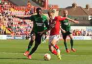 Joe Bryan (centre) of Bristol City takes on Hakeeb Adelakun (left) of Scunthorpe United during the Sky Bet League 1 match at Ashton Gate, Bristol<br /> Picture by Tom Smith/Focus Images Ltd 07545141164<br /> 06/09/2014
