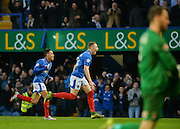 Portsmouth striker Caolan Lavery turns to celebrate after scoring the opening goal during the Sky Bet League 2 match between Portsmouth and Hartlepool United at Fratton Park, Portsmouth, England on 12 December 2015. Photo by Adam Rivers.
