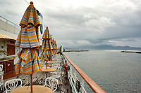 "(Image one of eight). Panorama of the Ensenada harbor in Mexico on a grey and raining day from the deck of the MV World Odyssey. The other cruse ship is the Carnival Imagination. Once all of the students, faculty, staff, and life long learners were aboard we would be ready to begin the 102 day ""round the world"" Semester at Sea Spring 2016 Voyage. Composite of eight images taken with a Nikon N1 V3 camera and 10-30 mm lens (ISO 200, 10 mm, f/11, 1/250 sec). Panorama stitched using AutoPano Giga Pro."