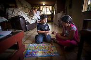 Yuliana Viloria (d) juega con su hermano, Miguel Alejandro (c) mientras su abuela paterna, Celida de Viloria (i) los observa. Gracias a FundaHigado, Yuliana recibió un trasplante de higado que le permite disfrutar de la vida. Punto Fijo, Venezuela 26 y 27 Oct. 2012. (Foto/ivan gonzalez)