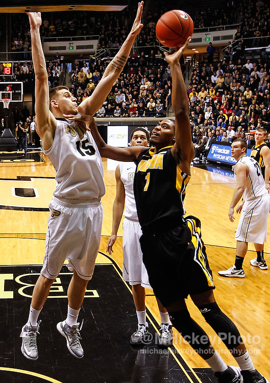 WEST LAFAYETTE, IN - JANUARY 27: Melsahn Basabe #1 of the Iowa Hawkeyes shoots the ball against Donnie Hale #15 of the Purdue Boilermakers at Mackey Arena on January 27, 2013 in West Lafayette, Indiana. Purdue defeated Iowa 65-62 in overtime. (Photo by Michael Hickey/Getty Images) *** Local Caption *** Melsahn Basabe; Donnie Hale
