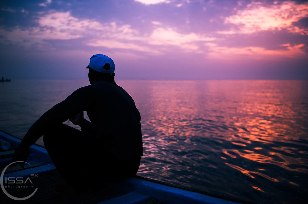 Omani fishermen waiting for his catch at sun rise
