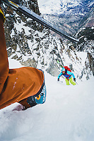 Andrew McLean, and Andy Dorais boot up a steep ski couloir in the Wasatch Mountains, Utah.
