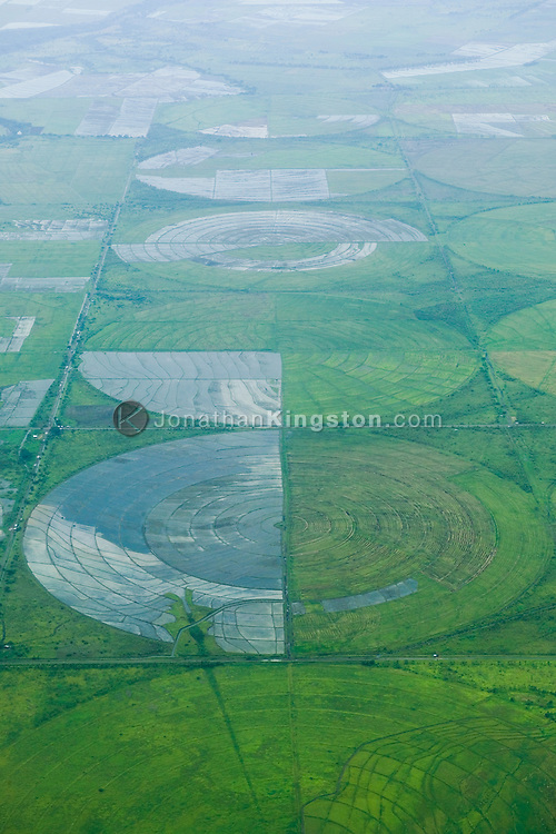 An aerial view of crop fields near Managua, Nicaragua.  <br /> For decades, Nicaragua has struggled to improve its economy following the aftermath of war and natural disasters such as Hurricane Mitch. At one time, the majority of Nicaraguan land was owned by a small percentage of people, until Sandinistas gained power and redistributed land in the 1980s, having mixed effects on agriculture.