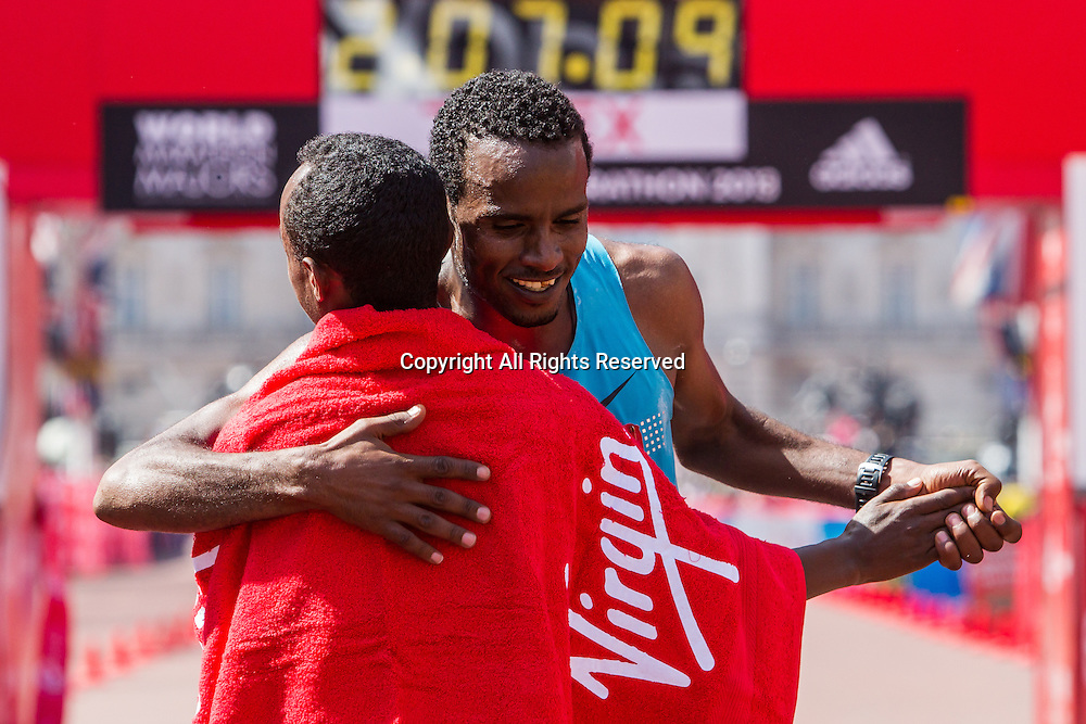 21.04.2013 London, England. Feyisa Lilesa (Ethiopia) congratulates men's winner Tsegaye Kebede (Ethiopia) during the The Virgin London Marathon.