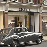 Vintage car parked in front of Chanel shop, Sloane Street, London