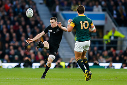 New Zealand Full Back Ben Smith kicks on past South Africa Fly-Half Handre Pollard - Mandatory byline: Rogan Thomson/JMP - 07966 386802 - 24/10/2015 - RUGBY UNION - Twickenham Stadium - London, England - South Africa v Wales - Rugby World Cup 2015 Semi Finals.