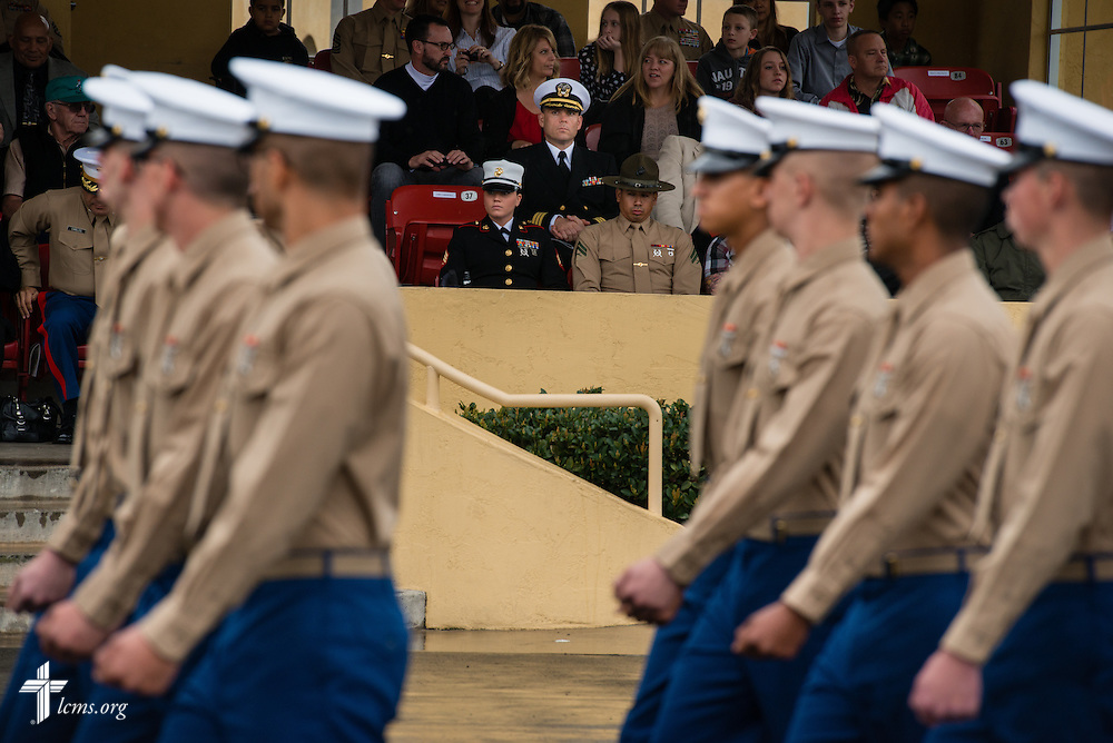 Cmdr. Charles E. Varsogea (center, seated), chaplain at the Marine Corps Recruit Depot, participates Friday, Jan. 30, 2015, in the recruit graduation ceremony at the depot in San Diego, Calif. LCMS Communications/Erik M. Lunsford
