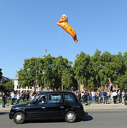 A balloon depicting the London Mayor, Sadiq Khan, wearing a yellow bikini is flown above parliament square. The balloon was crowd funded by its creator Yanny Breuer in response to the the Trump baby inflatable used during the visit of Donald Trump, earlier in the year; London, 01 September 2018.