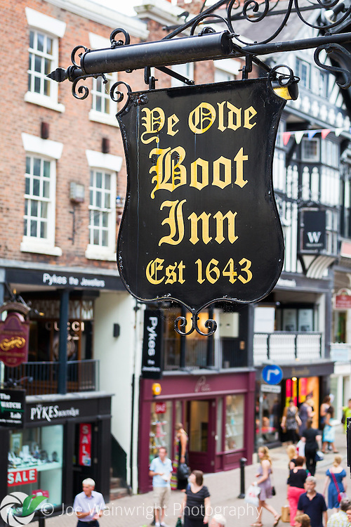 Photographed from Eastgate Street Row North, the sign for the 17th century Boot Inn, Chester, Cheshire.