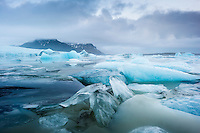 Icebergs in Fjallsárlón glacial lagoon, southeast Iceland.