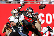 TAMPA, FL - DECEMBER 28: Jimmy Graham #80 of the New Orleans Saints draws a pass interference penalty in the end zone against Orie Lemon #45 of the Tampa Bay Buccaneers in the second half of the game at Raymond James Stadium on December 28, 2014 in Tampa, Florida. The Saints defeated the Bucs 23-20. (Photo by Joe Robbins/Getty Images)