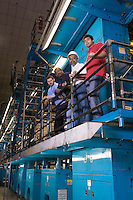 People working in newspaper factory low angle